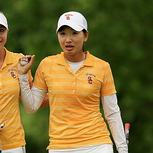 USC's Doris Chen, center, and Sophia Popov, left, after Chen won the individual honors during the final round of the Women's 2014 NCAA Division 1 Golf Championships at Tulsa Country Club.