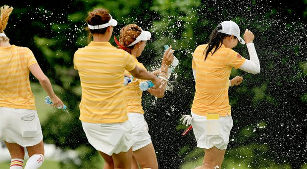 Doris Chen of USC tries to escape the sprays of water from her teammates after she won the individual honor at the 2014 NCAA Division I Women's Golf Championships at Tulsa (Okla.) Country Club.