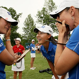 Duke's Celine Boutier, left, celebrates with teammate Sandy Choi and assistant coach, Jeanne Cho, far right, after they won the Women's 2014 NCAA Division 1 Golf Championships at Tulsa Country Club.
