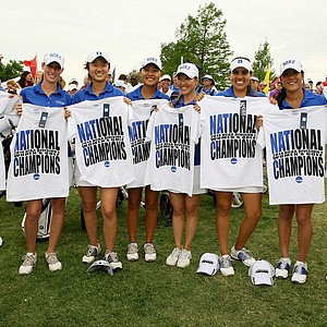 Duke hold up their National Champion T-shirts after winning the Women's 2014 NCAA Division 1 Golf Championships at Tulsa Country Club.