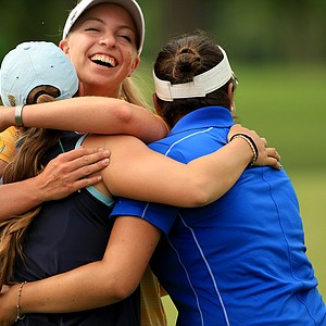 Duke's Alejandra Cangrejo (right) and USC's Sophia Popov (center), both seniors, hug emotional classmate Ani Gulugian of UCLA during the final round of the Women's 2014 NCAA Division I Golf Championships at Tulsa (Okla.) Country Club.