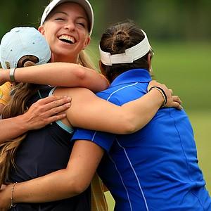 Duke's Alejandra Cangrejo (right) and USC's Sophia Popov (center), both seniors, hug emotional classmate Ani Gulugian of UCLA during the final round of the Women's 2014 NCAA Division I Golf Championships at Tulsa (Okla.) Country Club.