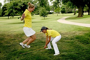 Iowa State's Cajsa Persson, left, and Prima Thammaraks have a little fun after their final round at the Women's 2014 NCAA Division 1 Golf Championships at Tulsa Country Club.