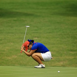 Kansas' Thanuttra Boonraksasat reacts to missing her birdie putt at No. 6 during the final round of the Women's 2014 NCAA Division 1 Golf Championships at Tulsa Country Club.