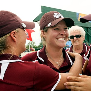 Mississippi State's Ally McDonald is surrounded by teammates after her final round of the Women's 2014 NCAA Division 1 Golf Championships at Tulsa Country Club.