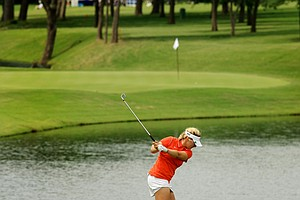 Viginia's Portland Rosen hits her shot at No. 6 during the final round of the Women's 2014 NCAA Division 1 Golf Championships at Tulsa Country Club.