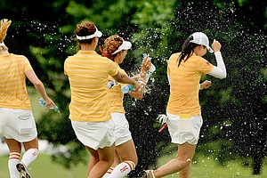 Doris Chen of USC tries to escape the sprays of water from her teammates after she won the individual honors at the Women's 2014 NCAA Division 1 Golf Championships at Tulsa Country Club.