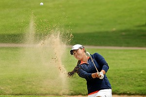 Virginia's Lauren Diaz-Yi hits out of a bunker at No. 5 during the final round of the Women's 2014 NCAA Division 1 Golf Championships at Tulsa Country Club.