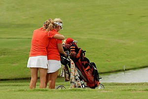 Virginia coach Kim Lewellen gives one of her senior players, Portland Rosen, a hug at No. 6 during the final round of the Women's 2014 NCAA Division 1 Golf Championships at Tulsa Country Club.