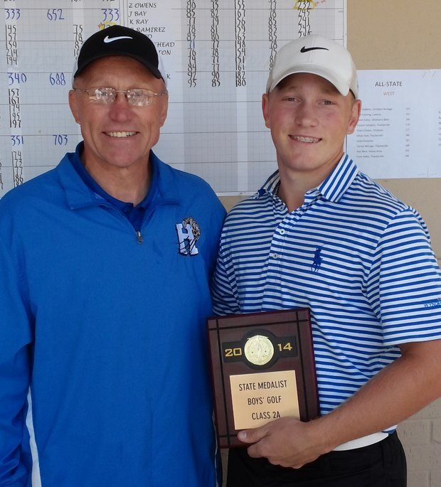 Brad Dalke and his dad, Bill, after winning the Oklahoma 2A State individual title.