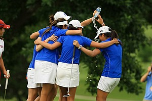 Duke players celebrate with teammate Celine Boutier (right) after the Blue Devils won the Women's 2014 NCAA Division I Golf Championships at Tulsa (Okla.) Country Club.