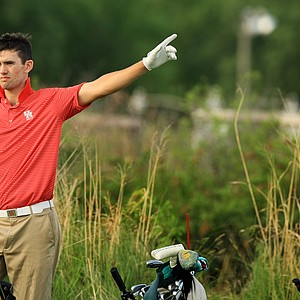 University of Houston's James Ross, signals another players ball left, at No. 1 during the NCAA Men's Division 1 Championship at Prairie Dunes Country Club in Hutchinson, Kan.