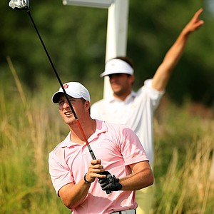 Oklahoma's Michael Schoolcraft hits left at No. 1 during the NCAA Men's Division 1 Championship at Prairie Dunes Country Club in Hutchinson, Kan.