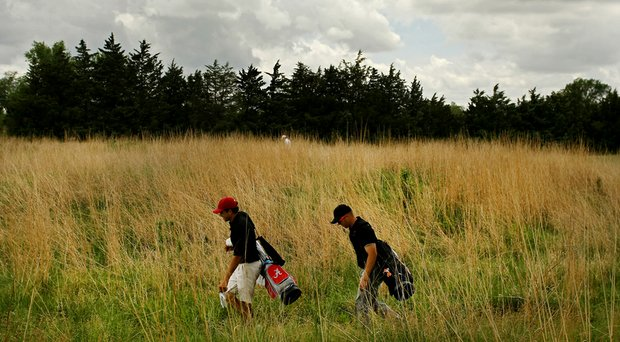 Alabama's Cory Whitsett and Oklahoma State's Talor Gooch walk to the seventh tee during Round 1 of the NCAA Men's Division 1 Championship at Prairie Dunes Country Club in Hutchinson, Kan.