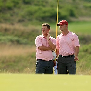 Oklahoma's Michael Gellerman, left, with head coach Ryan Hybl during the NCAA Men's Division 1 Championship at Prairie Dunes Country Club in Hutchinson, Kan.