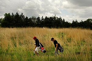 Alabama's Cory Whitsett and Oklahoma State's Talor Gooch walk to the 7th tee during Round 1 of the NCAA Men's Division 1 Championship at Prairie Dunes Country Club in Hutchinson, Kan.