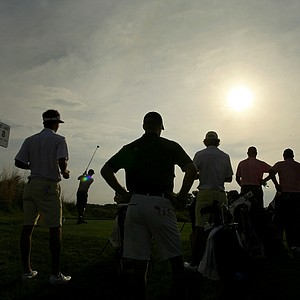 LSU, Vanderbilt and Oklahoma players double up at No. 8 as the sun starts to set on Saturday play during the NCAA Men's Division 1 Championship at Prairie Dunes Country Club in Hutchinson, Kan.