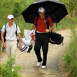 Anthony Paolucci of USC, right, and UCLA's Lorens Chan, make their way down No. 12 on Sunday of the NCAA Men's Division 1 Championship at Prairie Dunes Country Club in Hutchinson, Kan.