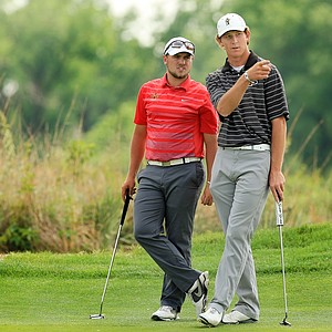 Iowa State's Sam Daley and Purdue's Austin Eoff, wait at No. 9 on Sunday of the NCAA Men's Division 1 Championship at Prairie Dunes Country Club in Hutchinson, Kan.