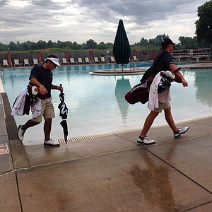South Carolina players head to the range after a rain delay at the NCAA Championship at Prairie Dunes Country Club in Hutchinson, Kan.