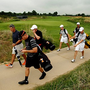 Oklahoma State head coach Alan Bratton and player, Talor Gooch walk in after the horn blew at 10:02 on Sunday of the NCAA Men's Division 1 Championship at Prairie Dunes Country Club in Hutchinson, Kan.