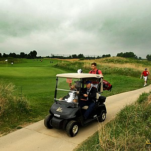 Players, coaches and spectators head back in after the horn was sounded at 10:02 on Sunday of the NCAA Men's Division 1 Championship at Prairie Dunes Country Club in Hutchinson, Kan.