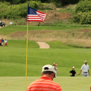 American Flag pins on the holes during Monday of the NCAA Men's Division 1 Championship at Prairie Dunes Country Club in Hutchinson, Kan.