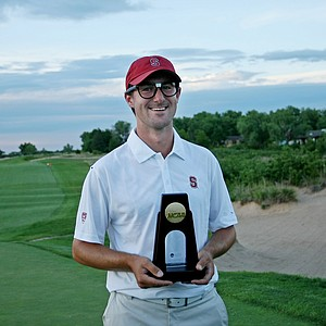 Stanford's Cameron Wilson poses with his nerd nation glasses and the individual champion trophy on Monday of the NCAA Men's Division 1 Championship at Prairie Dunes Country Club in Hutchinson, Kan.