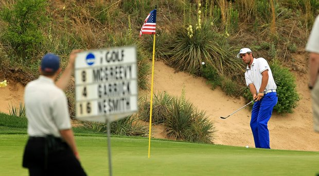 UCLA's Jonathan Garrick chips up to No. 18 on Monday of the NCAA Men's Division 1 Championship at Prairie Dunes Country Club in Hutchinson, Kan.