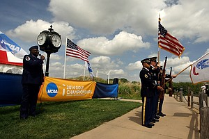 In honor of Memorial Day, Master Sargeant Fred Johnson, with the Kansas Air National Guard on Monday, sings the National Anthem as the Army color guard Kansas Recruiting Company presents the colors at the NCAA Men's Division 1 Championship at Prairie Dunes Country Club in Hutchinson, Kan.