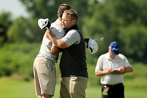 Ryan Zech of Missouri gets a hug from his assistant coach Judd Easterling after finishing his third round on Monday of the NCAA Men's Division 1 Championship at Prairie Dunes Country Club in Hutchinson, Kan.