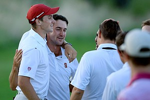 Stanford's Patrick Rodgers congratulates his teammate Cameron Wilson after Wilson took individual honors on Monday of the NCAA Men's Division 1 Championship at Prairie Dunes Country Club in Hutchinson, Kan.