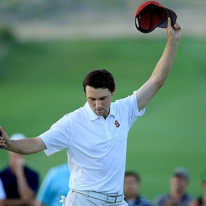 Stanford's Cameron Wilson celebrates winning the individual title on Monday at the NCAA Men's Division 1 Championship at Prairie Dunes Country Club in Hutchinson, Kan.