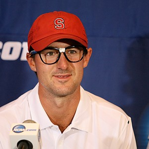 Cameron Wilson of Stanford wears goofy glasses in the press conference after winning the individual honors on Monday of the NCAA Men's Division 1 Championship at Prairie Dunes Country Club in Hutchinson, Kan.
