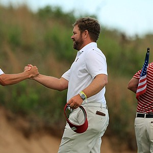 Stanford head coach, Conrad Ray, congratulates Cameron Wilson after completion of his third round on Monday of the NCAA Men's Division 1 Championship at Prairie Dunes Country Club in Hutchinson, Kan.