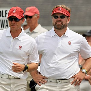 Stanford head coach, Conrad Ray, center, with assistant, Phillip Rowe, left, on Monday of the NCAA Men's Division 1 Championship at Prairie Dunes Country Club in Hutchinson, Kan.