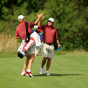 Alabama head coach Jay Seawell high fives his senior Trey Mullinax upon learning they deafeated LSU during Tuesday semifinals of match play of the NCAA Men's Division 1 Championship at Prairie Dunes Country Club in Hutchinson, Kan.