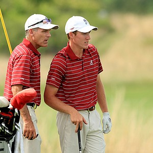 Alabama's assistant, Mike McGraw with Robby Shelton during Tuesday's semifinals of match play of the NCAA Men's Division 1 Championship at Prairie Dunes Country Club in Hutchinson, Kan.
