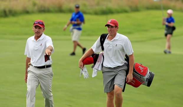 Alabama's Robby Shelton with assistant coach Mike McGraw during Tuesday quarterfinals of match play of the NCAA Men's Division 1 Championship at Prairie Dunes Country Club in Hutchinson, Kan.