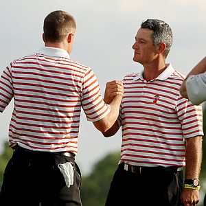 Oklahoma State coach, Alan Bratton, congratulates his player Wyndham Clark, after he defeated Viraat Badhwar of Stanford during Tuesday semifinals of match play of the NCAA Men's Division 1 Championship at Prairie Dunes Country Club in Hutchinson, Kan.