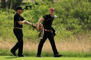 Oklahoma State assistant coach Brian Guetz with Jordan Niebrugge at No. 17 during Tuesday quarterfinals of match play of the NCAA Men's Division 1 Championship at Prairie Dunes Country Club in Hutchinson, Kan.