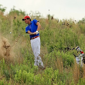 SMU's Andrew Buchanan attempts a shot at No. 18 before conceding his match at No. 18 during Tuesday quarterfinals of match play of the NCAA Men's Division 1 Championship at Prairie Dunes Country Club in Hutchinson, Kan.