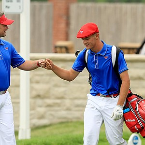 SMU head coach Josh Gregory with Bryson Dechambeau at No. 10 tee during Tuesday quarterfinals of match play of the NCAA Men's Division 1 Championship at Prairie Dunes Country Club in Hutchinson, Kan.