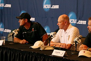 Stanford's Conrad Ray, far right, makes his picks with official Mike Carter and Oklahoma State coach, Alan Bratton, afterTuesday quarterfinals of match play of the NCAA Men's Division 1 Championship at Prairie Dunes Country Club in Hutchinson, Kan.