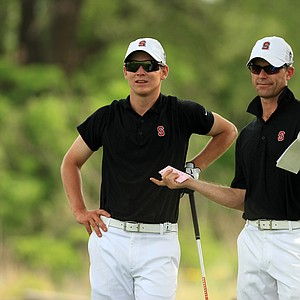 Stanford assistant coach Phil Rowe, right, with David Boote, discuss hole No. 7, during Tuesday semifinals of match play of the NCAA Men's Division 1 Championship at Prairie Dunes Country Club in Hutchinson, Kan.
