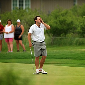 Alabama's Tom Lovelady reacts to his putt at No. 9 during Tuesday quarterfinals of match play of the NCAA Men's Division 1 Championship at Prairie Dunes Country Club in Hutchinson, Kan.