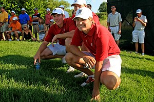 Alabama's Bobby Wyatt, Tom Lovelady and Robby Shelton watch as Trey Mullinax sets up for his putt during Wednesday final match play of the NCAA Men's Division 1 Championship between Alabama and Oklahoma State at Prairie Dunes Country Club in Hutchinson, Kan.