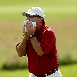 Alabama head coach Jay Seawell tries to keep cool during Wednesday's match-play final of the NCAA Men's Division I Championship between Alabama and Oklahoma State at Prairie Dunes Country Club in Hutchinson, Kan.