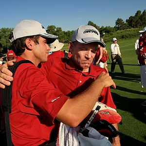 Alabama's Cory Whitsett shares a moment with assistant coach, Mike McGraw, after they defeated Oklahoma State, McGraw's former team at the NCAA Men's Division 1 Championship between Alabama and Oklahoma State at Prairie Dunes Country Club in Hutchinson, Kan.