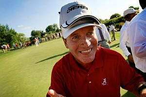 Alabama head coach Jay Seawell shows off his two hats, one being a National Championship hat, after defeating Oklahoma State in final match play of the NCAA Men's Division 1 Championship between Alabama and Oklahoma State at Prairie Dunes Country Club in Hutchinson, Kan.